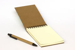 Recycled paper notepad and pen Royalty Free Stock Images