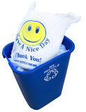 Recycled Plastic Bag  HappyFace. Plastic bag with a happy face is shown in a recycle bin Stock Images