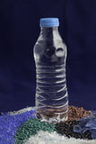Recycled plastic polymers out of PET water bottle Royalty Free Stock Photos