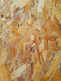 Recycled Pressed Wood Board Background. A Recycled Pressed Wood Scraps Board Background Royalty Free Stock Photos