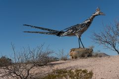 Recycled Roadrunner sculpture near Las Cruces, New Mexico. Olin Calk first recycled the rubbish for this sculpture in 1993. Later,2014, he revised his creation royalty free stock photo