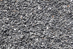 Recycled Rubber, Playground Mulch. Bed of recycled, chopped rubber tire on a walking path or playground Stock Photos