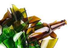 Recycled.Shattered green and brown bottle Stock Images