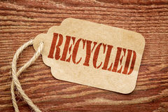 Recycled sign on a paper price tag Stock Images