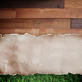 Recycled torn paper on wood background. Stock Photo