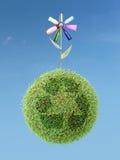 De bloem van Eco op groene kringloopplaneet stock foto