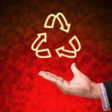 Recycleer van licht met hand Royalty-vrije Stock Afbeelding