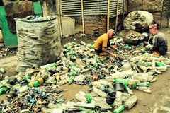 Recycler. Capture of people who earns their living going from door to door collecting household trash and ensure that these disposable stuff cant harm our Royalty Free Stock Photos