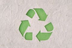 Recyclig symbol on recycled paper. Ecology concept Royalty Free Stock Photo