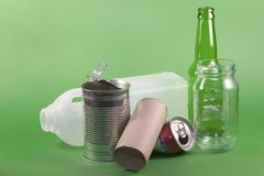 Recycling #1. Collection of items for recycling on a green background, concept of protecting the enviroment Royalty Free Stock Photos