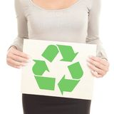Recycling. Woman showing the recycle sign / symbol on recycled paper. Isolated on white background Stock Photos