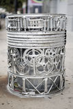 Recycling. Trash can made of used bicycle pedals Stock Photo
