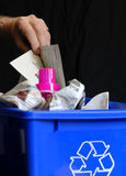 Recycling. Hand putting recycling in bin with plastic and paper Royalty Free Stock Photos