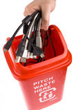 Recycling. A red recycling bin full of recyclable things-electrical wire,tTerminal Stock Images