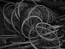 Recycling. Bicycle wheels in a pile for recycling Royalty Free Stock Photography