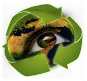 Recycling arrows and earth in eye. Closeup of recycling arrows and earth in eye Royalty Free Stock Photos