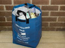 A recycling bag provided by the local council in Bangor Northern Ireland filled with waste collected over a few days in a local pe. A recycling bag provided by Royalty Free Stock Image