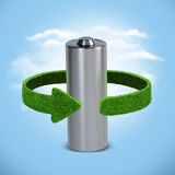 Recycling batteries and accumulators. Concept with green arrows from the grass. Recycling concept. Concept background of  batteries  accumulator Royalty Free Stock Photo