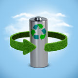 Recycling batteries and accumulators. Concept with green arrows from the grass. Recycling concept Stock Photos