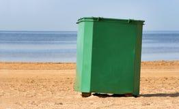 Recycling bin. Green metal recycling bin on the beach near Riga Bay, Latvia Stock Photos