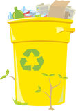 Recycling Bin. Filled curbside recycling bin with small plants growing around it Royalty Free Stock Photo