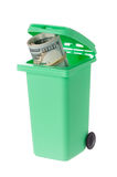 Recycling bin with banknotes Stock Images