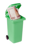 Recycling bin with cash. Green recycling bin with a one hundred Norwegian krona bill inside isolated on white Stock Image