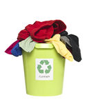 Recycling bin with clothes. And fabric isolated on white background Stock Photos