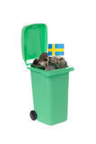 Recycling bin with coins Stock Photo