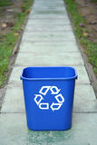 Recycling bin in the middle of a path. Please recycle to save our future Stock Photos