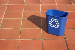 Recycling bin in the middle of a path Stock Photos