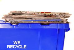 Recycling bin with newspapers Stock Photos