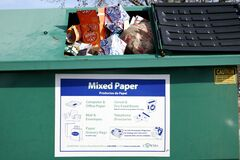 Recycling bin for paper refuse.