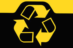 Recycling bin sign. Sign on recycling bin with yellow recycling logo Stock Photography