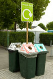 Recycling Bins. Four recycling bins with a sign above detailing that items can be recycled Stock Photos