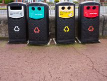 Recycling Bins. A row of four recycling bins for general waste, glass and plastic  bottles and aluminium cans Stock Image