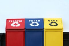 Recycling bins. Three recycling bins for plastic, paper and aluminium cans Royalty Free Stock Photography