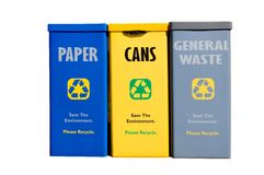 Recycling bins against white background Royalty Free Stock Photos