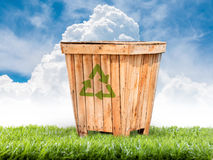 Recycling bins made of wood on the lawn Stock Photo