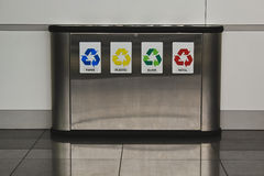 Recycling bins. Metal recycling bin in at the wall in a public place for paper, plastic, glass and metal Royalty Free Stock Images