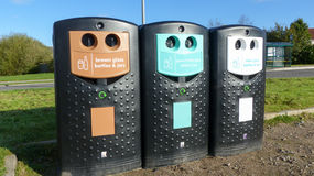 Recycling Bins. Three recycling bins for brown green and white glass Royalty Free Stock Photography