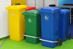 Recycling bins. Three new plastic recycling bins for sorting waste stock photos