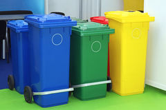Recycling Bins. Three Plastic Recycling Bins For Sorting Waste stock photo