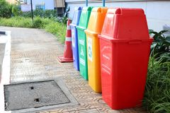 Recycling bins, yellow, red, green, blue for sorting in the dumping of garbage  in Nakhon Sawan Province, Thailand, March 31, 2019. Recycling bins yellow red stock images