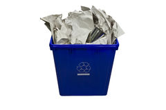 Recycling. A blue bin full of paper and metal can for recycling purpose on white background stock photos