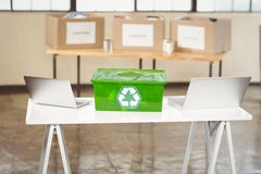 Recycling box amidst laptop Stock Image