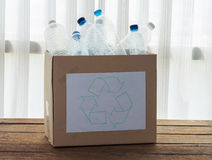 Recycling box filled with clear plastic containers Stock Image