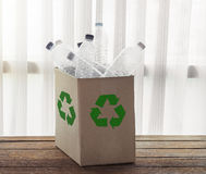 Recycling box filled with clear plastic containers Royalty Free Stock Image