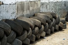 Tire Recycling Center. Recycling business with metal container and car tires beside it stock photography