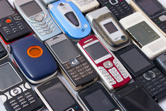 Recycling Cellphones. Multiple old and damaged cellphones ready to be recycled Stock Photography